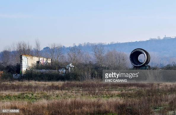 Ruins are pictured at the site of the former chemical factory AZF in Toulouse southern France on January 20 2017 Who is responsible for the disaster...