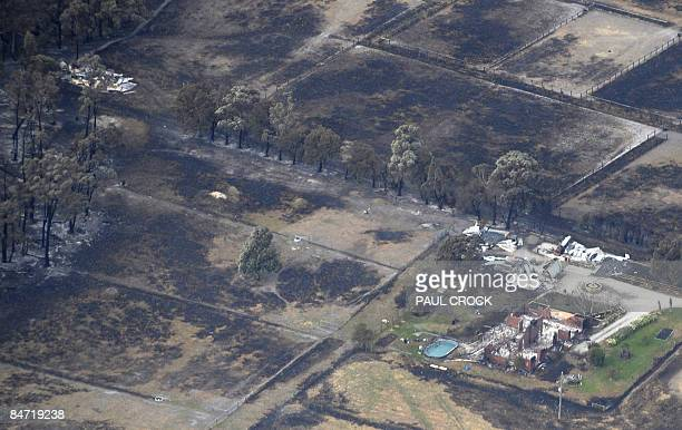 Ruins of a home and sheds after a wildfire ripped through the area destroying thousands of hectares of farmland and eucalypt forest near Bunyip some...