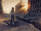 ruins of the city with and the boy  in the street. Photo combination  concept