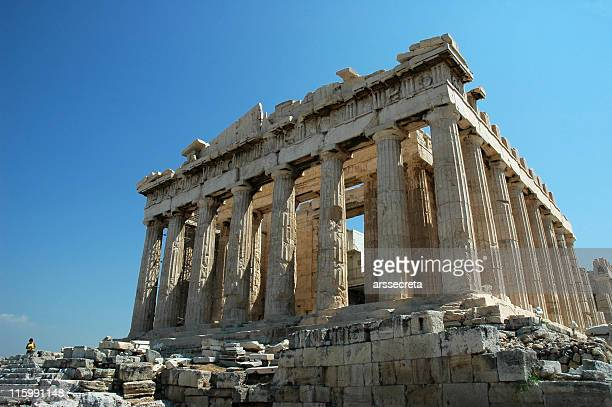 Ruins of the Parthenon in Greece against a blue sky