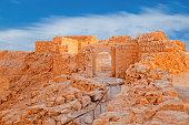 Ruins of Massada Fortress in Negev at sunset