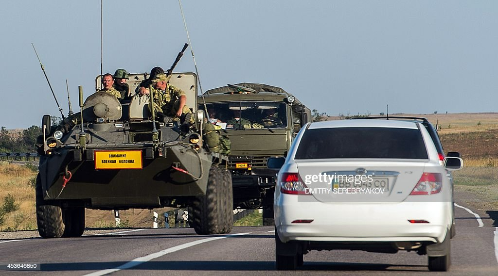 A Ruissian armoured personnel carrier leads a column of military vehicles on a road near the town of KamenskShakhtinsky in the Rostov region some 30...