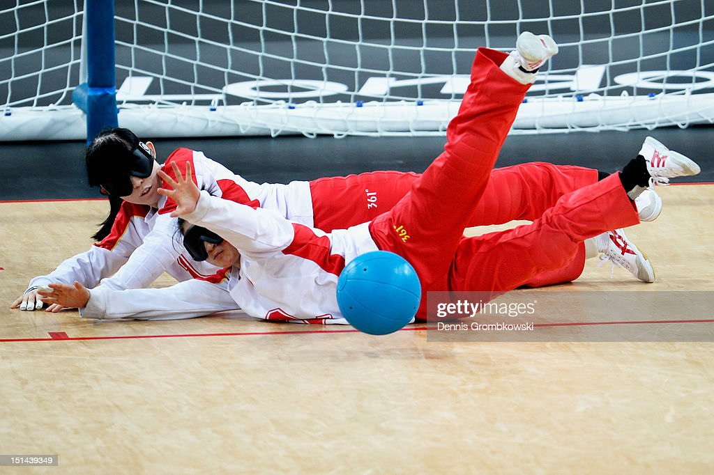 Ruixue Wang of China and teammate Fengqing Chen block the ball during their Women's Team Goalball Gold Medal match against Japan on day 9 of the London 2012 Paralympic Games at The Copper Box on September 7, 2012 in London, England.
