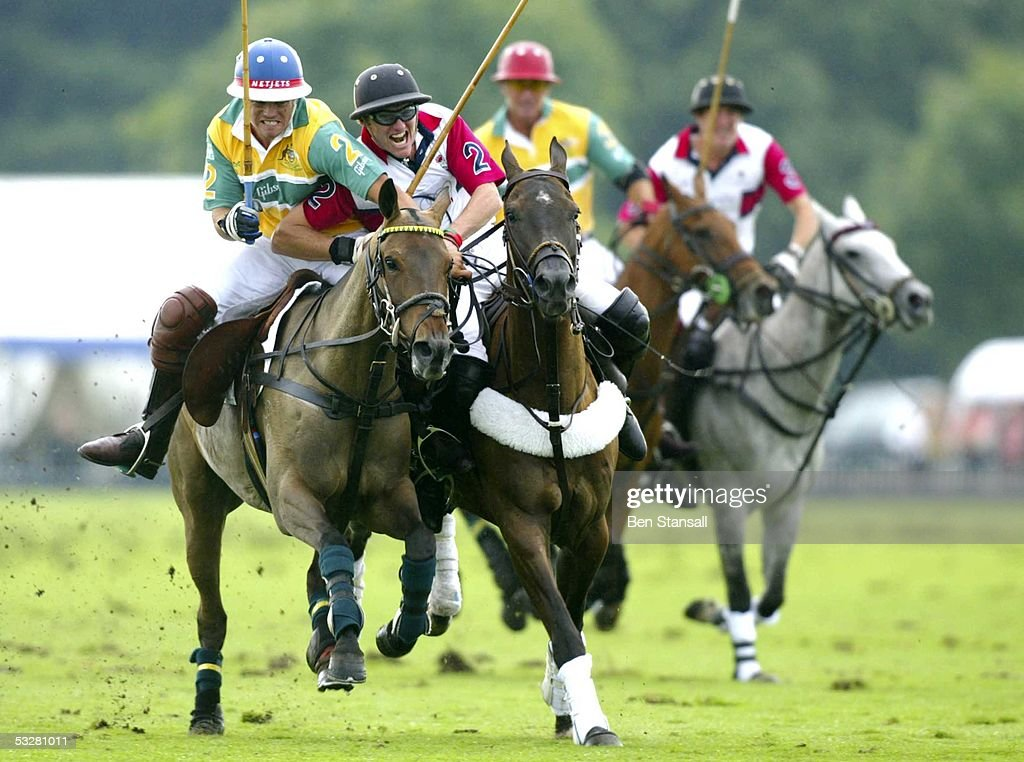 Ruki Bailieu and Mark Tomlinson compete on Cartier International Day at Guards Polo Club Windsor Great Park on July 24 2005 in Windsor England