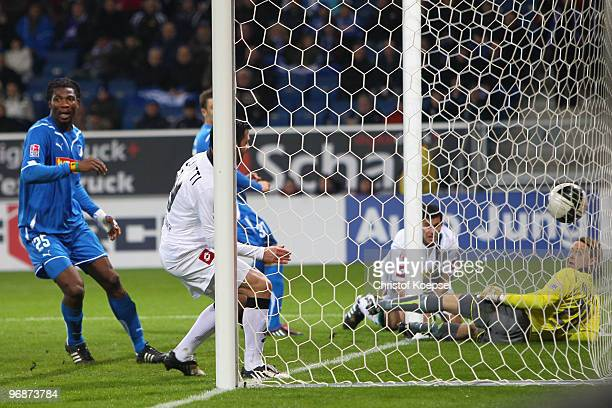 Rául Marcelo Bobadilla of Gladbach scores his team's second goal against goalkeeper Timo Hildebrand of Hoffenheim during the Bundesliga match between...