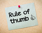 Rule of Thumb Message. Recycled paper note pinned on cork board. Concept Image