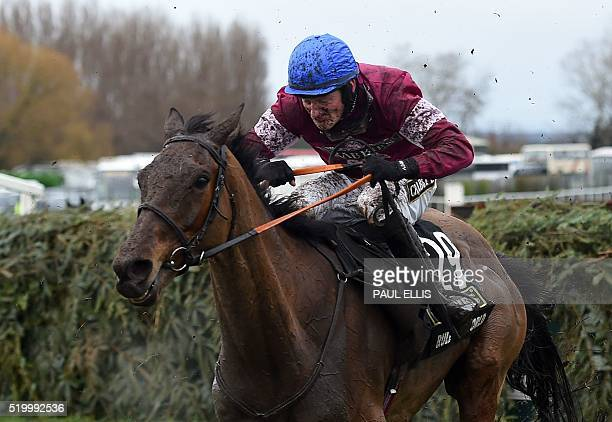Rule the World by David Mullins jumps the final fence to win the Grand National at Aintree Racecourse in Liverpool north west England on April 9 2016...