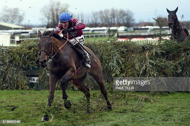 TOPSHOT Rule the World by David Mullins jumps the final fence to win the Grand National at Aintree Racecourse in Liverpool north west England on...