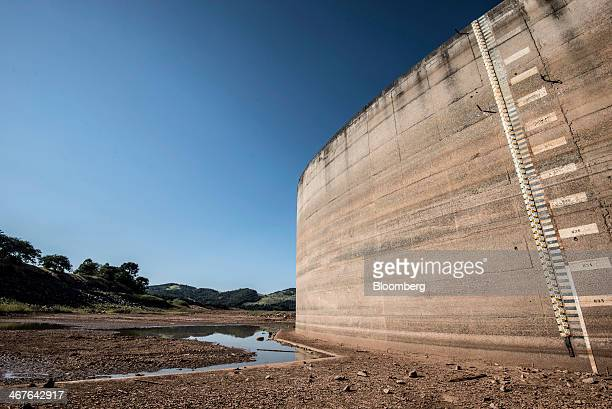 A ruler measuring the water level is displayed on the side of the Jaguari Dam managed by Cia de Saneamento Basico do Estado de Sao Paulo known as...