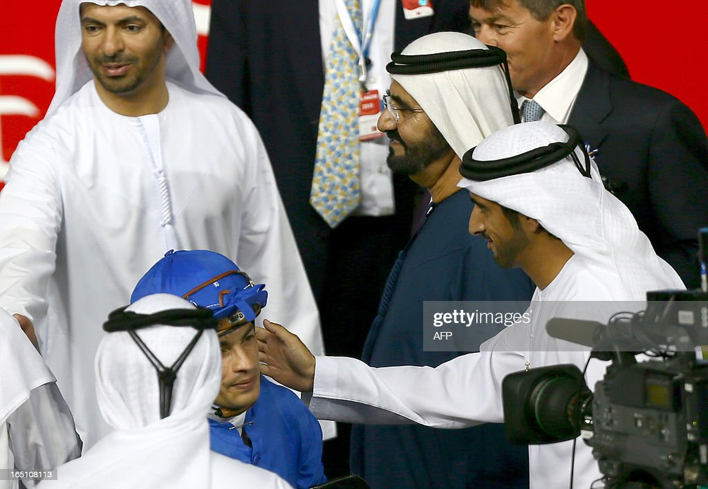 Ruler of Dubai Sheikh Mohammed Bin Rashid al-Maktoum (C), and his son Crown Prince Sheikh Hamdan (R) congaratulate Jockey Silvester De Sousa who after leading Sajjhaa, owned by Godolphin stables, to win in the Dubai Duty Free part of the Dubai World Cup meet, the world's richest race, at Meydan race track in Dubai March 30, 2013.