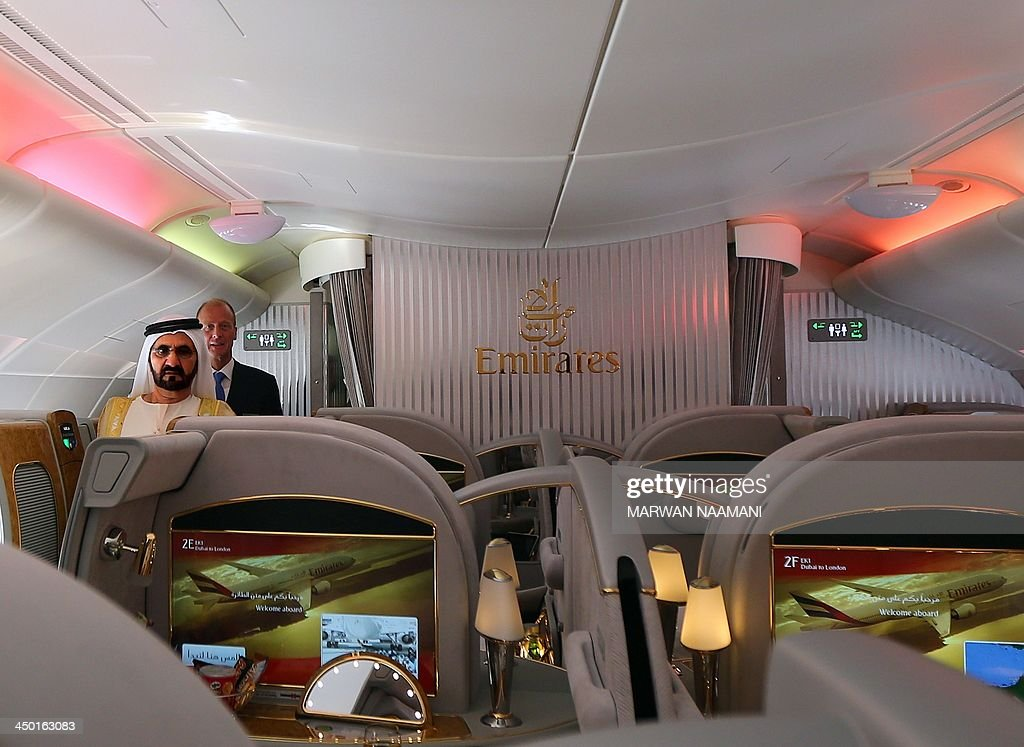 Ruler of Dubai Sheikh Mohammed Bin Rashid al-Maktoum (L), takes a tour of the Emirates A380 airliner, alongside Tom Enders (2nd-L), chief executive of the European aerospace giant EADs, during the opening ceremony of the Dubai Airshow on November 17, 2013. AFP PHOTO/MARWAN NAAMANI