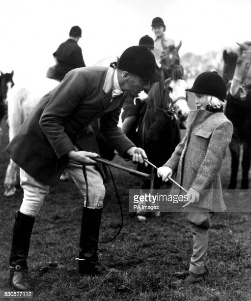 Rules are rigid in the hunting field and here young follower Anne TyldenWright gets expert instruction from Huntsman Charlie Allen before the move...