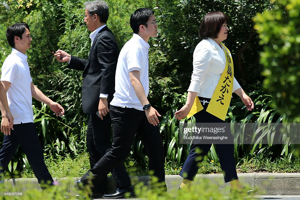Ruling coalition junior partner New Komeito Party (NKP) candidate Take Itou (R) arrives to her election campaign for the upper house election on June 27, 2016 in Kobe, Japan. Japanese Prime Minister Shinzo Abe joined the campaign to show support for a candidate from Komeito for the first time. The Komeito is a coalition partner of his Liberal Democratic Party.