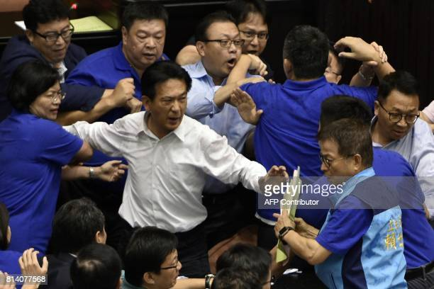 Ruling Democratic Progressive Party legislators brawl with opposition Kuomintang and People First Party legislators calling for a boycott of the...