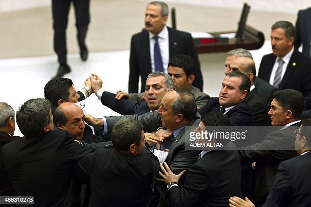 Ruling Justice and Development Party lawmakers and main opposition Republican People's Party scuffle during a debate focused on corruption charges...