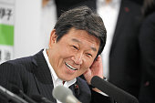 Ruling Liberal Demcratic Party election campaign committee chair Toshimitsu Motegi smiles at the LDP headqharters on July 10 2016 in Tokyo Japan Exit...