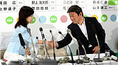 Ruling Liberal Demcratic Party Policy Council Chairwoman Tomomi Inada and election campaign committee chair Toshimitsu Motegi shake hands at the LDP...