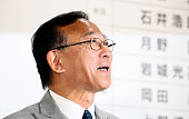 Ruling Liberal Demcratic Party Secretary General Sadakazu Tanigaki smiles during a press conference at the LDP headqharters on July 10 2016 in Tokyo...