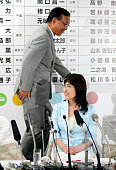 Ruling Liberal Demcratic Party Secretary General Sadakazu Tanigaki and Policy Council chair Tomomi Inada share smiles at the LDP headqharters on July...