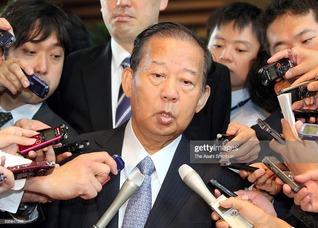 Ruling Liberal Democratic Party General Council Chairman <a gi-track='captionPersonalityLinkClicked' href=/galleries/search?phrase=Toshihiro+Nikai&family=editorial&specificpeople=569783 ng-click='$event.stopPropagation()'>Toshihiro Nikai</a> speaks to media reporters after his meeting with Prime Minister Shinzo Abe at Abe's official residence on May 30, 2016 in Tokyo, Japan. Abe has decided to postpone the scheduled increase in the consumption tax rate, from 8 to 10 percent, citing sluggish global economic conditions and the powerful earthquakes that struck Kyushu. Abe will not dissolve the Lower House for a snap election for voters' opinion on his decision.