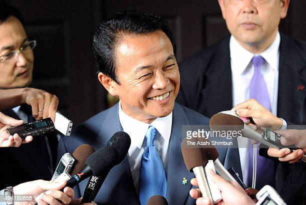 Ruling Liberal Democratic Party presidential election candidate speaks to media reporters in front of his house ahead of voting on September 22 2008...