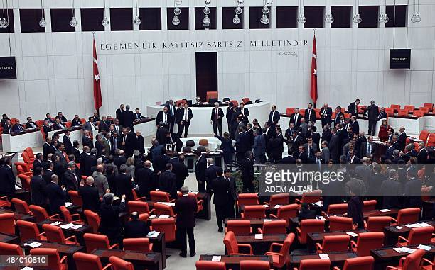 Ruling party and opposition Turkish lawmakers scuffle during a debate over a controversial bill to boost police powers against protesters at the...