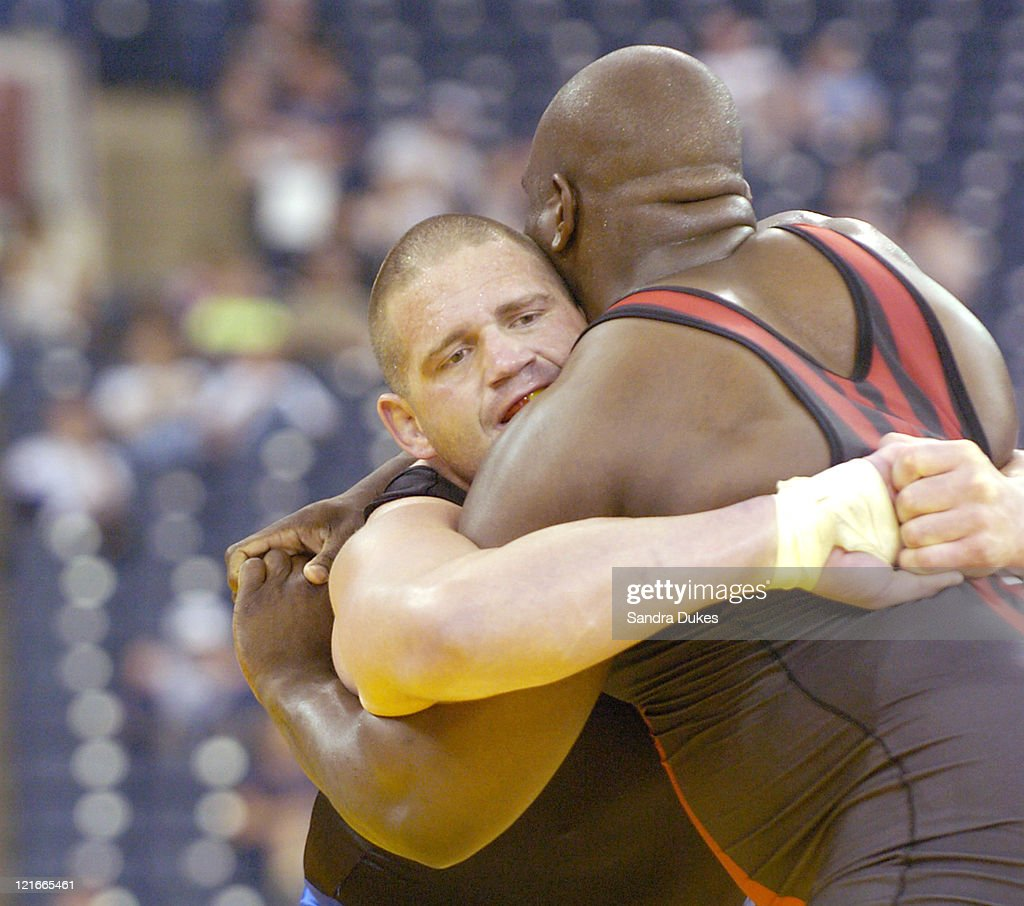 Rulon Gardner has Dremiel Byers in a clinch in 120 kg GrecoRoman finals at the Olympic Trials in Indianapolis Indiana