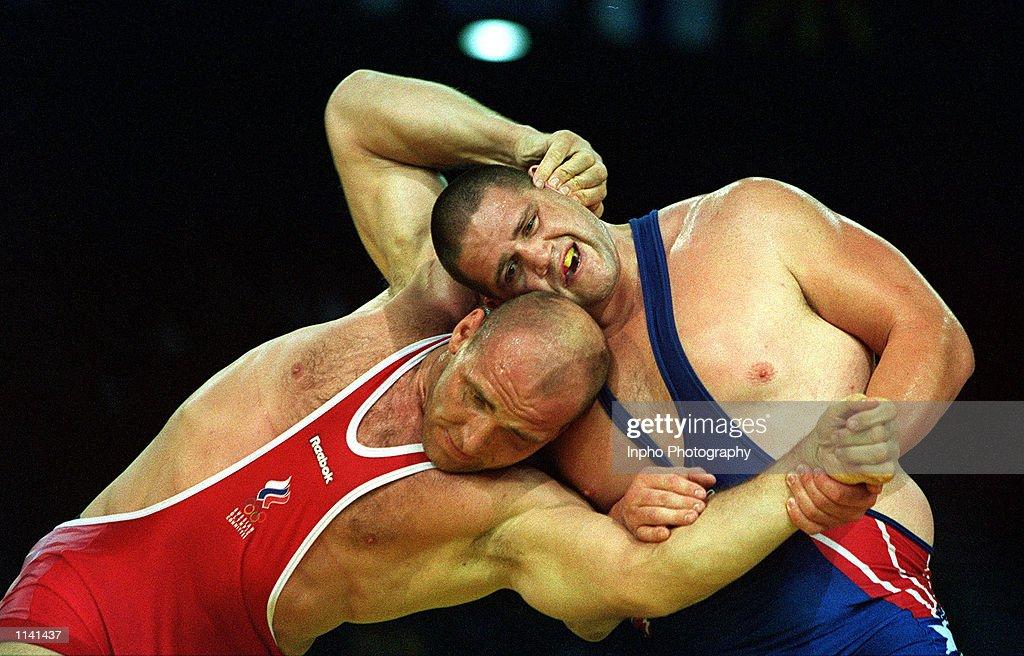 Rulon Gardner of USA right wrestles against Alexandre Karelin of Russia in the 130 kilogram event September 27 2000 during the Sydney 2000 Olympic...