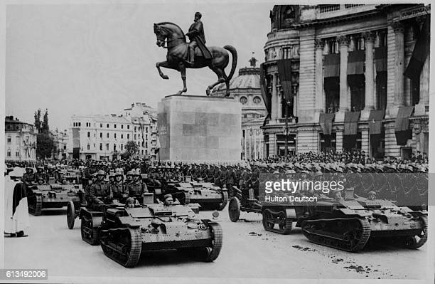 Rumania's Military Might Parades Before King Karol In Bucharest Tanks Guns armoured cars and other items of the Rumanian fighting forces parade past...