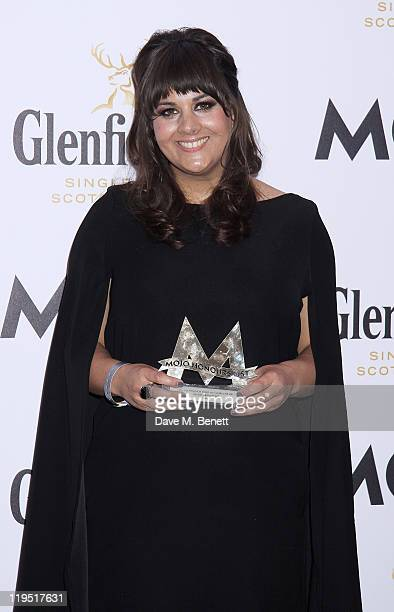Rumer poses in front of the winners boards after winning the MOJO Breakthrough Award at the Glenfiddich Mojo Honours List 2011 awards ceremony at The...