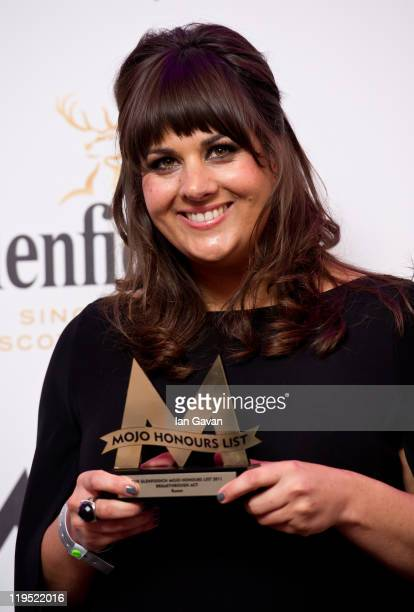Rumer poses in front of the winners boards after winning the MOJO Breakthrough Award at the Glenfiddich Mojo Honours List 2011 at The Brewery on July...
