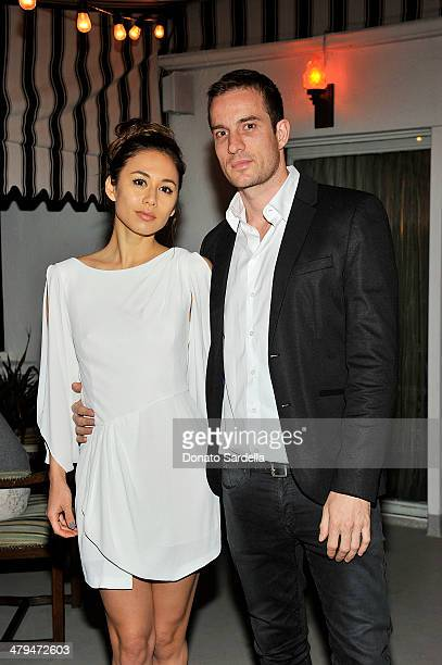 Rumi Neely and Chris Dowson attend Eva Mendes Exclusively at New York Company Spring launch dinner at Chateau Marmont on March 18 2014 in Los Angeles...