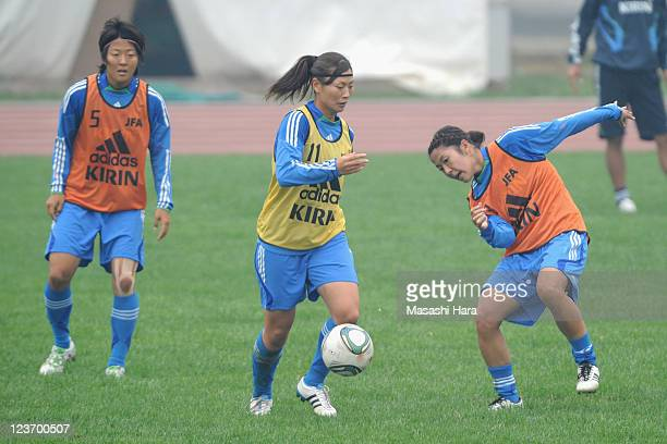 Rumi Utsugi and Asano Nagasato compete for the ball during the training session at yyyy on September 4 2011 in Jinan China