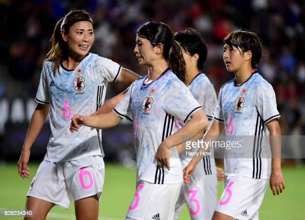 Rumi Utsugi Aya Sameshima Yuika Sugasawa and Rin Sumida of Japan walk off the field at half trailing the United States 10 eventually losing 30 during...