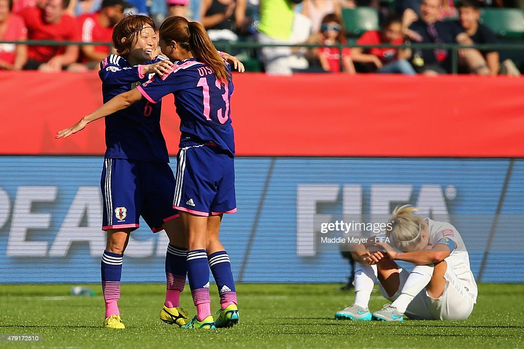 Rumi Utsugi #13 of Japan and Mizuho Sakaguchi #6 celebrate after their teams 2-1 win over England in the FIFA Women's World Cup Canada 2015 semi final match at Commonwealth Stadium on July 1, 2015 in Edmonton, Alberta, Canada.