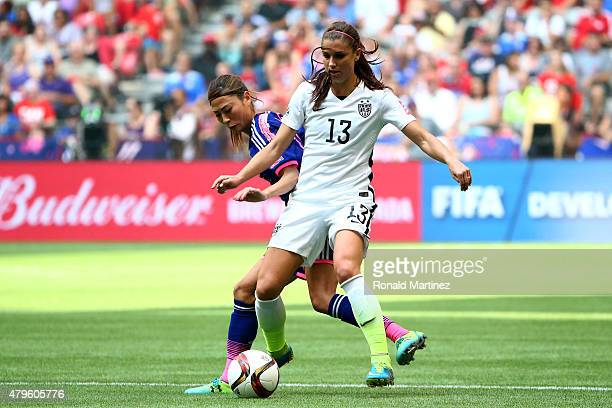 Rumi Utsugi of Japan challenges Alex Morgan of the United States of America in the FIFA Women's World Cup Canada 2015 Final at BC Place Stadium on...