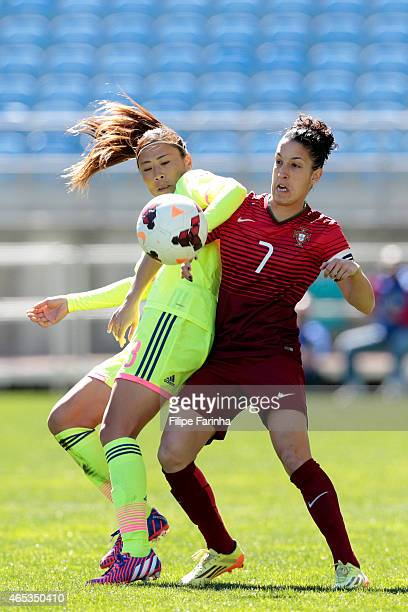 Rumi Utsugi of Japan challenges Claudia Neto of Portugal during the Women's Algarve Cup match between Japan and Portugal on March 6 2015 in Faro...