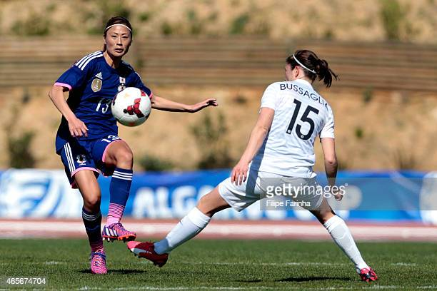 Rumi Utsugi of Japan challenges Elise Bussaglia of France during the Women's Algarve Cup match between Japan and France on March 9 2015 in Parchal...