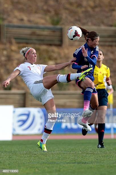 Rumi Utsugi of Japan challenges Sanne Troelsgaard of Denmark during the Women's Algarve Cup match between Japan and Denmark on March 4 2015 in...