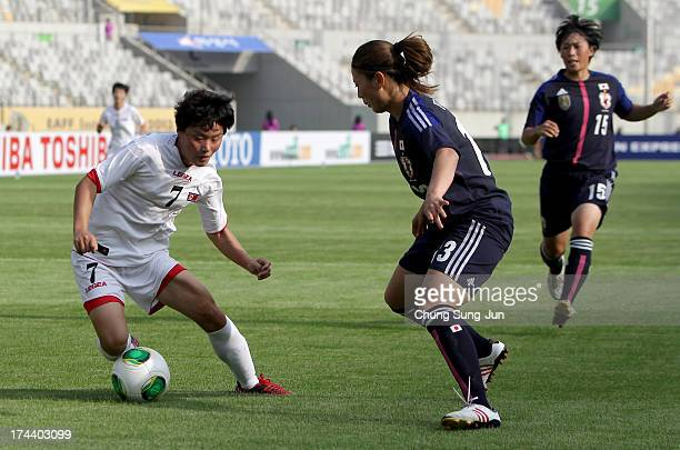 Rumi Utsugi of Japan competes for the ball with Kim SuGyong of North Korea during the EAFF Women's East Asian Cup match between Japan and Korea DPR...