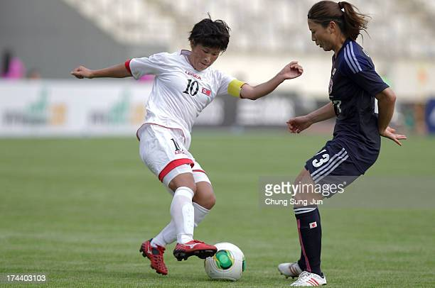 Rumi Utsugi of Japan competes for the ball with Ra UmSim of North Korea during the EAFF Women's East Asian Cup match between Japan and Korea DPR at...