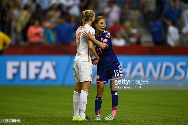Rumi Utsugi of Japan consoles Vivianne Miedema of Netherlands at the end of the FIFA Women's World Cup 2015 Round of 16 match between Japan and...