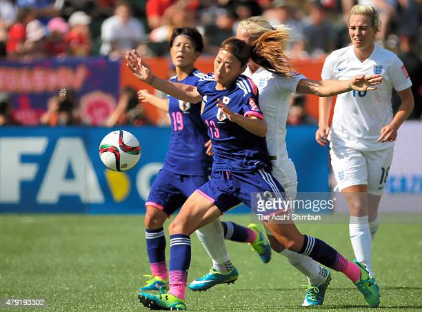 Rumi Utsugi of Japan controls the ball during the FIFA Women's World Cup 2015 Semi Final match between Japan and England at Commonwealth Stadium on...