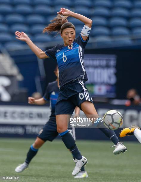 Rumi Utsugi of Japan defends against Brazil during the 2017 Tournament of Nations at CenturyLink Field on July 27 2017 in Seattle Washington