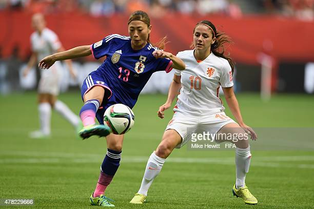 Rumi Utsugi of Japan is challenged by Danielle van de Donk of Netherlands during the FIFA Women's World Cup 2015 Round of 16 match between Japan and...