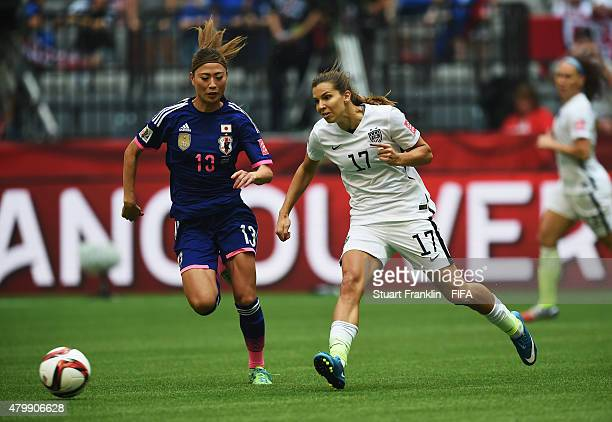 Rumi Utsugi of Japan is challenged by Tobin Heath of USA during the FIFA Women's World Cup Final between USA and Japan at BC Place Stadium on July 5...