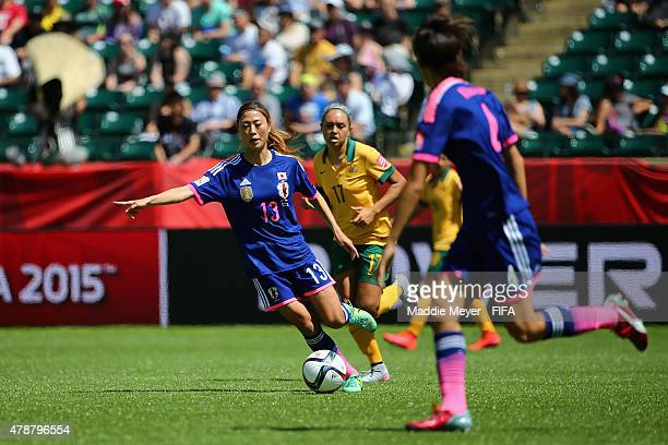 Rumi Utsugi of Japan makes a pass during the FIFA Women's World Cup Canada 2015 quarter final match between Japan and Australia at Commonwealth...