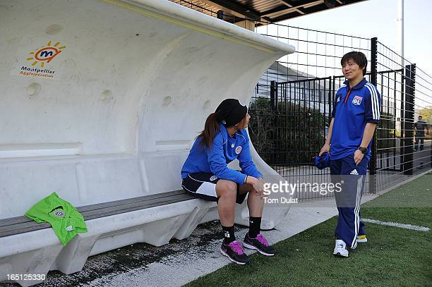 Rumi Utsugi of Montpellier HSC and Shinobu Ohno of Olympic Lyonnais chat during the Championnat de France D1 Feminine match between Montpellier HSC...