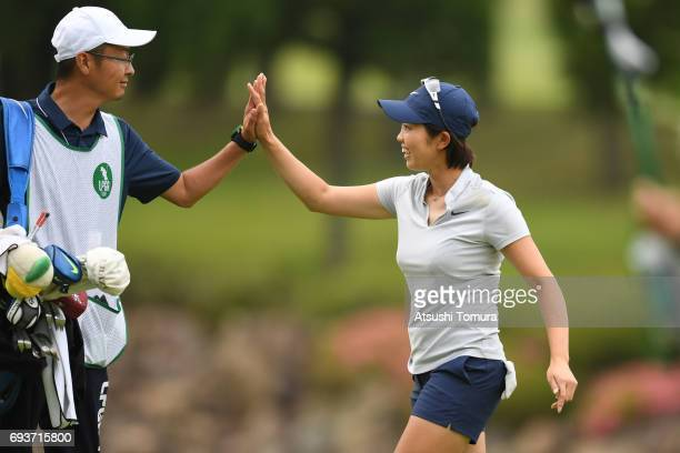 Rumi Yoshiba of Japan celebrates after making her eagle shot on the 18th hole during the first round of the Suntory Ladies Open at the Rokko Kokusai...