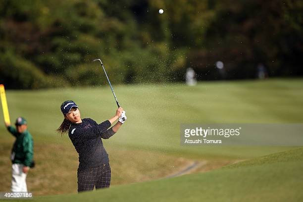 Rumi Yoshiba of Japan hits from a bunker on the 14th hole during the final round of the Higuchi Hisako Ponta Ladies at the Musashigaoka Golf Course...